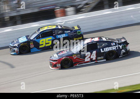 Brooklyn, Michigan, USA. 12th Aug, 2018. Kasey Kahne (95) and William Byron (24) battle for position during the Consumers Energy 400 at Michigan International Speedway in Brooklyn, Michigan. Credit: Chris Owens Asp Inc/ASP/ZUMA Wire/Alamy Live News - Stock Photo