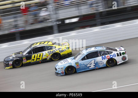 Brooklyn, Michigan, USA. 12th Aug, 2018. Gray Gaulding (99) and Kevin Harvick (4) battle for position during the Consumers Energy 400 at Michigan International Speedway in Brooklyn, Michigan. Credit: Chris Owens Asp Inc/ASP/ZUMA Wire/Alamy Live News - Stock Photo