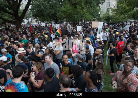 Washington, DC, USA. 12th August, 2018.   Some of the thousands of demonstrators at a counter-protest in Lafayette Square, while only a handful of white nationalists held their Unite the Right rally nearby in front of the White House on the one year anniversary of the violent Charlottesville, Virginia rally. Bob Korn/Alamy Live News - Stock Photo