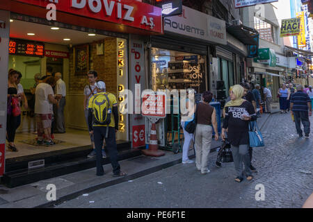 Istanbul, Turkey. 13th August, 2018. People are waiting in front of the change office amid Turkish market rattled by economic crisis Credit: Engin Karaman/Alamy Live News - Stock Photo