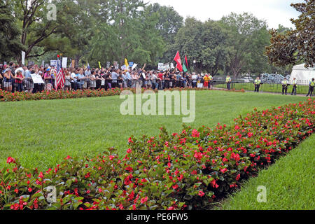 Washington D.C., USA. 12th August, 2018.  Counterprotesters demonstrate in Lafayette Park against the 'Unite the Right 2' rally happening across from them.  A police line separates the counterprotesters from the alt-right rally participants.  Credit: Mark Kanning/Alamy Live News. - Stock Photo