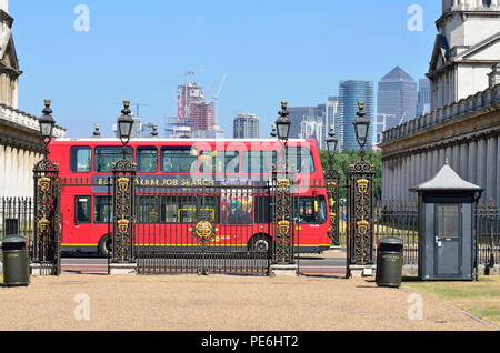 Red Double Decker bus passing the gate to Queen's House, Greenwich, England 180627 73623 - Stock Photo