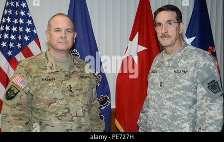 Lt. Gen. Timothy Kadavy, director of the Army National Guard, visits with Maj. Gen. James Joseph, Pennsylvania's adjutant general, at Fort Indiantown Gap, Pa., Oct. 2, 2015. The 17,000-acre Army National Guard maneuver training installation is the headquarters for the Pennsylvania National Guard and Department of Military and Veterans Affairs. - Stock Photo