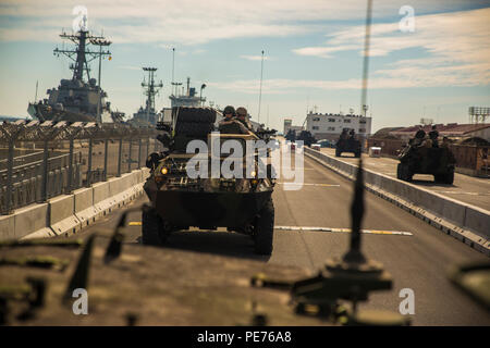 Marines with 4th Light Armored Reconnaissance Battalion, 4th Marine Division, Marine Forces Reserve, conduct a road march in light armored vehicles in Rota, Spain, Oct. 23, 2015, in support of Exercise Trident Juncture 2015. The exercise is the largest NATO exercise in the past 10 years that includes more than 5,000 U.S. service members out of 36,000 troops from more than 30 nations. - Stock Photo