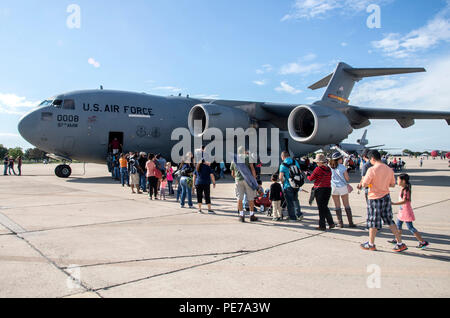 Members of the San Antonio community board a C-17 Globemaster III during the 2015 Joint Base San Antonio Air Show and Open House Oct. 31, 2015, at JBSA-Randolph, Texas. Air shows allow the Air Force to display the capabilities of our aircraft to the American taxpayer through aerial demonstrations and static displays and allowing attendees to get up close and personal to see some of the equipment and aircraft used by the U.S. military today. (U.S. Air Force photo by Johnny Saldivar) - Stock Photo