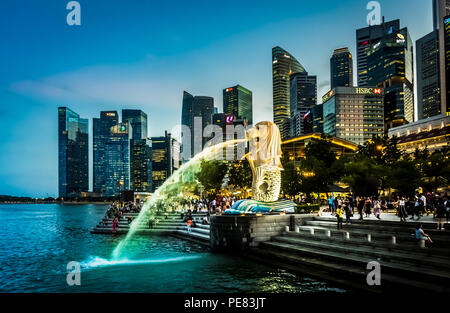 Singapore - Sept 22, 2017: Merlion in front of Fullerton Hotel and skyscrapers of Marina bay, Singapore. - Stock Photo