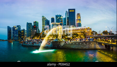 Singapore - Sept 22, 2017: Merlion infront of  Fullerton Hotel and sky scrapers at Marina bay, Singapore. - Stock Photo