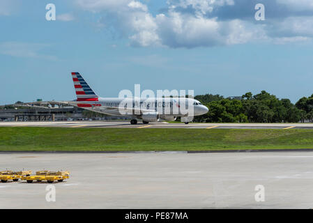 Aircraft taxiway on elevated section at Tampa International Airport, Florida, USA. 2018. An American comapny Airbus A319 on the taxiway - Stock Photo
