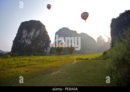Hot air balloons take off in Yangshou, China - Stock Photo