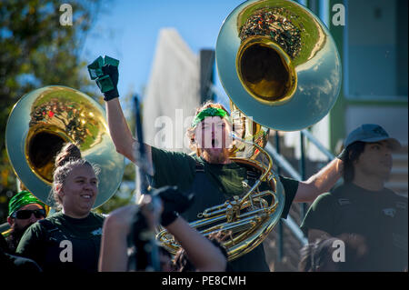 Eastern New Mexico University Greyhound Sound Marching Band tuba player Taylor Hamner cheers on the ENMU football team at their military appreciation game Oct. 24, 2015 in Portales, N.M. The military appreciation game was the last home game of the season for ENMU, and the last game in their Blackwater Draw Stadium before its replacement, slated for 2016. - Stock Photo