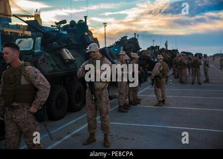 Marines with 4th Light Armored Reconnaissance Battalion, 4th Marine Division, prepare for a long road march from Rota, Spain, to Alvarez de Sotomayor for exercise Trident Juncture 2015, on Oct. 25, 2015. Trident Juncture, the largest NATO exercise in the 10 years, includes more than 5,000 U.S. service members and more than 36,000 troops from other allied nations. - Stock Photo