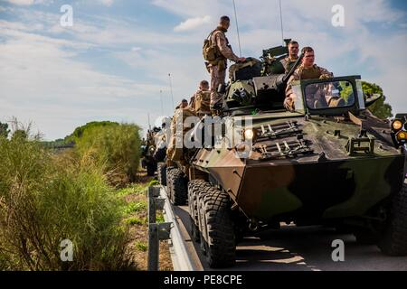 Marines with 4th Light Armored Reconnaissance Battalion, 4th Marine Division, halt during a convoy to Alvarez de Sotomayor during exercise Trident Juncture, Oct. 25, 2015. Trident Juncture is the largest exercise NATO has held in the past 10 years. - Stock Photo