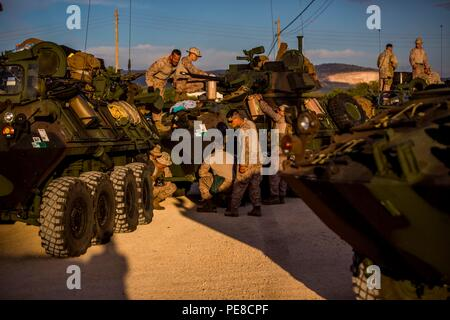 Marines with 4th Light Armored Reconnaissance Battalion, 4th Marine Division, stop at a checkpoint in Spain to perform maintenance during a road march to Alvarez de Sotomayor during exercise Trident Juncture, Oct. 25, 2015. Trident Juncture is the largest NATO exercise in the 10 years with more than 5,000 U.S. service members and over 36,000 troops from other allied. - Stock Photo
