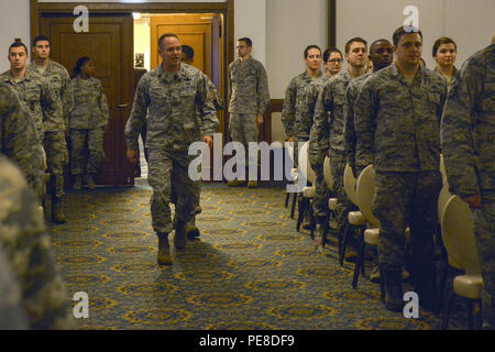 Brig. Gen. Jon T. Thomas, 86th Airlift Wing commander, enters the room to begin a commander's call Oct. 20, 2015, at Ramstein Air Base, Germany. The event's purpose was to allow Thomas the opportunity to give his background and explain his vision for the wing. - Stock Photo