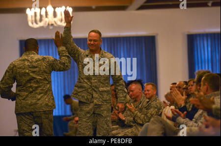 Brig. Gen. Jon T. Thomas, 86th Airlift Wing commander, high-fives Chief Master Sgt. Phillip L. Easton, 86th AW command chief, during the commander's call Oct. 20, 2015, at Ramstein Air Base, Germany. The event allowed Thomas to share his vision for the wing as well as other pertinent information. - Stock Photo