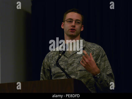 """First Lt. Keenan Kunst, 86th Airlift Wing Public Affairs deputy chief, speaks during a commander's call Oct. 20, 2015, at Ramstein Air Base, Germany. Kunst discussed the new Ramstein app, which, according to Brig. Gen. Jon T. Thomas, 86th AW commander, is """"an easy to learn, intuitive workhorse that provides the information you need for life in the Kaiserslautern Military Community right in the palm of your hand."""" - Stock Photo"""