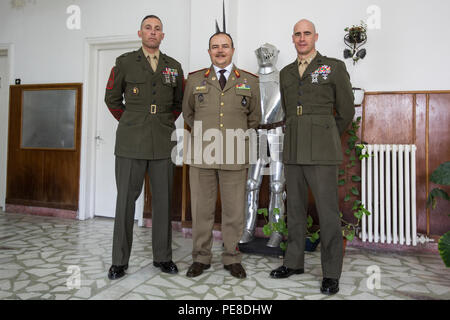 From left, Sgt. Maj. Paul T. Costa, sergeant major of the Black Sea Rotational Force, Brig. Gen. Adrian Soci, with the Romanian 9th Mechanized Brigade, and Lt. Col. Kemper A. Jones, commanding officer of BSRF, pose during an exhibit opening at Constanta, Romania, Oct. 25, 2015. The exhibit was introduced in honor of Romania's Armed Forces Day, and the event U.S. and Romanian military members the opportunity to engage with one another and the local community. (U.S. Marine Corps photo by Lance Cpl. Melanye E. Martinez/Released) - Stock Photo