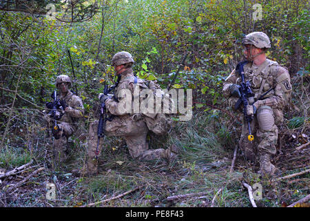 U.S. paratroopers from 2nd Battalion, 503rd Infantry Regiment, 173rd Airborne Brigade, provide security during a live-fire exercise as part of Exercise Rock Proof V at Pocek Range in Postonja, Slovenia, Oct. 21, 2015. Exercise Rock Proof V is a bilateral training exercise between U.S. Soldiers assigned to 173rd Airborne Brigade and the Slovenian Armed Forces, focused on small-unit tactics and building interoperability between allied forces. (U.S. Army photo by Visual Information Specialist Paolo Bovo/Released) - Stock Photo