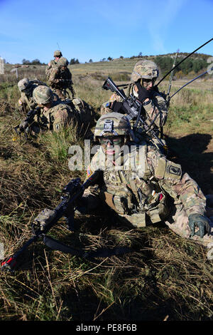 A U.S. paratrooper from 2nd Battalion, 503rd Infantry Regiment, 173rd Airborne Brigade, provides security during a live-fire exercise as part of Exercise Rock Proof V at Pocek Range in Postonja, Slovenia, Oct. 21, 2015. Exercise Rock Proof V is a bilateral training exercise between U.S. Soldiers assigned to 173rd Airborne Brigade and the Slovenian Armed Forces focused on small-unit tactics and building interoperability between allied forces. (U.S. Army photo by Visual Information Specialist Paolo Bovo/Released) - Stock Photo
