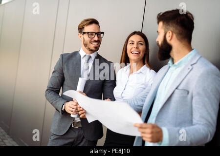 Group of perspective designers discussing in office - Stock Photo