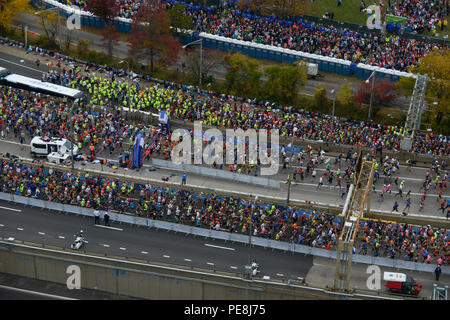 Runners participating in the New York City Marathon, begin the race from Coast Guard Sector New York in Staten Island, New York, Nov. 1, 2015. The Coast Guard has been behind the scenes, working to produce a functioning event and ensuring that every aspect of the start of the race runs smoothly for the athletes, spectators, and volunteers. (U.S. Coast Guard photo by Frank Iannazzo-Simmons) - Stock Photo