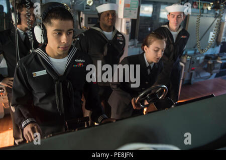 151030-N-XM324-011BUSAN, Republic of Korea (Oct. 30, 2015) Sailors stand watch on the bridge of the Arleigh Burke-class guided-missile destroyer USS Fitzgerald (DDG 62) as the ship arrives in Busan. Fitzgerald is participating in bilateral training with the Republic of Korea Navy to strengthen the U.S.-ROK alliance and improve regional security. (U.S. Navy photo by Mass Communication Specialist 3rd Class Patrick Dionne/Released) - Stock Photo