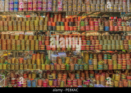 Colorful Indian bangles on display at a market in Penang, Malaysia - Stock Photo