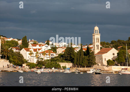 The campanile of the 15th century Franciscan Monastery, Hvar, Croatia, seen from across the harbour - Stock Photo