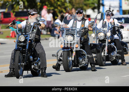 Members of Rolling Thunder® Inc., Chapter NC-5, ride motorcycles in the 20th Annual Veterans Day Parade in Jacksonville, NC, Nov. 7, 2015. The Veterans Day Parade, hosted by Rolling Thunder Inc. Chapter NC-5, was observed by veterans, Service members and residents of Jacksonville and showed support for members of the armed forces. (U.S. Marine Corps photo by Staff Sgt. Neill A. Sevelius, MCIEAST-MCB CAMLEJ Combat Camera/Released) - Stock Photo