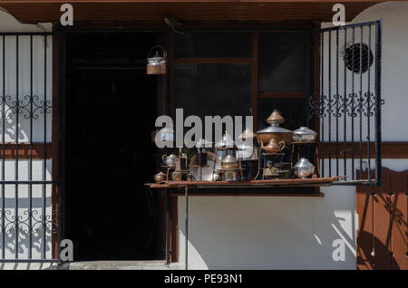 Ancient vintage Copper bowls, copper containers, pots and pans and old nostalgic iron - Stock Photo