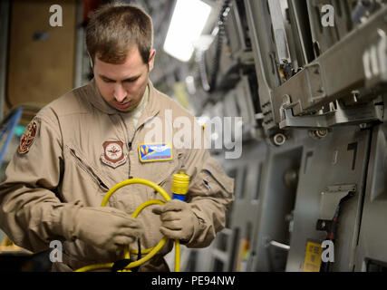Tech. Sgt. Derek Matway, 10th Expeditionary Aeromedical Evacuation Flight technician, configures power for medical equipment Nov. 10, 2015, at Ramstein Air Base, Germany. Aeromedical evacuation Airmen can use a variety of aircraft in the Air Force arsenal to get the injured home and save lives. The aircraft powers the equipment needed to treat all types of injuries mid-flight. (U.S. Air Force photo/Staff Sgt. Armando A. Schwier-Morales) - Stock Photo