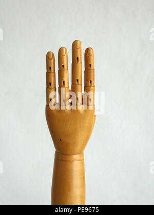 Wooden Hand Manikin making gestures - Stock Photo