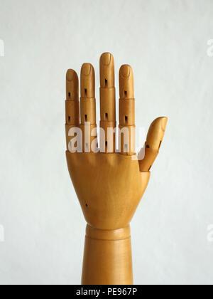 Wooden Hand Manikin making five finger gestures - Stock Photo