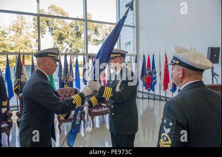 151113-N-HD670-214 PORT HUENEME, Calif. (Nov. 13, 2015) - Capt. Ronald Gruzesky passes the 1st Naval Construction Regiment's (1 NCR) guidon to Capt. Steven Kelley during a change of command ceremony. During the ceremony, Kelly relieved Gruzesky as commodore of 1 NCR. The 1 NCR exercises peacetime command and control over Naval Mobile Construction Battalions (NMCB) 18, based at Fort Lewis, Wash., NMCB 22, in Fort Worth, Texas, and NMCB 25 in Port Hueneme. (U.S. Navy photo by Utilitiesman 3rd Class Stephen Sisler/Released) - Stock Photo