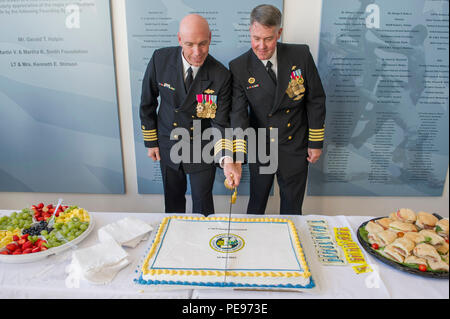 151113-N-HD670-379 PORT HUENEME, Calif. (Nov. 13, 2015) - Capt. Steven Kelley and Capt. Ronald Gruzesky, cut a cake during 1st Naval Construction Regiment's (1 NCR) change of command ceremony. During the ceremony, Kelly relieved Gruzesky as commodore of 1 NCR. 1 NCR exercises peacetime command and control over Naval Mobile Construction Battalions (NMCB) 18, based at Fort Lewis, Wash., NMCB 22, in Fort Worth, Texas, and NMCB 25 in Port Hueneme. (U.S. Navy photo by Utilitiesman 3rd Class Stephen Sisler/Released) - Stock Photo
