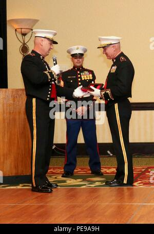Col. Peter D. Buck, left, presents Maj. Gen. Charles L. Hudson, right, with a gift at the Headquarters and Headquarters Squadron 240th Marine Corps Birthday Ball, held at the Marriott Resort and Spa in Hilton Head, S. C., Nov. 06, 2015. Maj. Gen. Hudson, the guest of honor, was presented with a gift as part of Marine Corps tradition. (U.S. Marine Corps photo by Lance Cpl. Kayla L. Douglass/Released) - Stock Photo