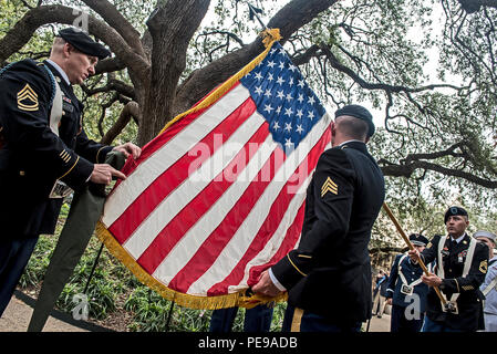 Members of the Joint Base San Antonio color guard prepare to case the American flag following a Veterans Day ceremony at the Alamo on Nov. 7, 2015. - Stock Photo