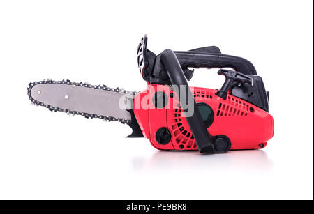 Red Chainsaw isolated on a white background. - Stock Photo