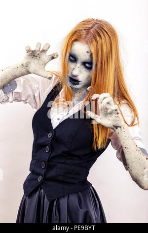 zombie girl attack with yellow hair in attack pose on white background - Stock Photo