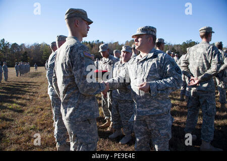 U.S. Army Maj. Gen. Robert E. Livingston Jr., Adjutant General for South Carolina, recognizes North Carolina Army National Guard Soldiers who supported the South Carolina flood response and recovery efforts in October during a ceremony at Camp Butner, N.C., Nov. 14, 2015. South Carolina experienced unprecedented flooding throughout many areas of the state in October due to historic rainfall. (U.S. Army National Guard Photo by Capt. Brian Hare/Released) - Stock Photo
