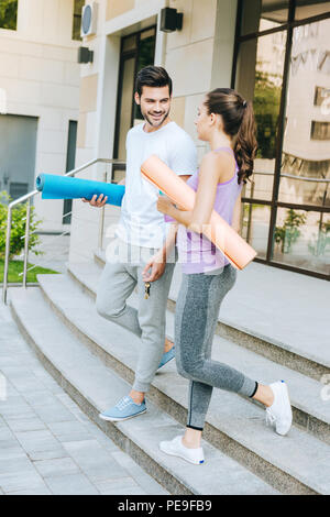 Positive nice people walking down the stairs - Stock Photo