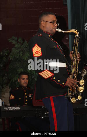 Gunnery Sgt. Jason Knuckles, member of the Marine Corps Recruit Depot Parris Island Jazz Combo, plays the saxophone during the Daniel Pearl World Music Days at the Daniel Pearl Education Center in East Brunswick, N.J., Oct. 28, 2015. The four-Marine band performed at four high schools in Middlesex County in addition to the Daniel Pearl World Music Days performance. - Stock Photo