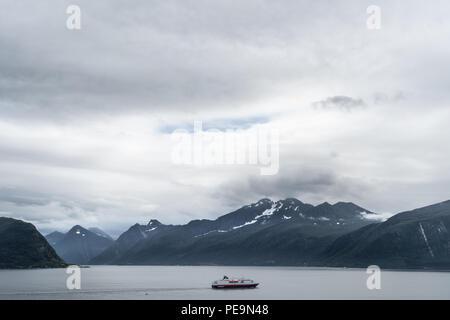 Hurtigruten and fjord - Stock Photo