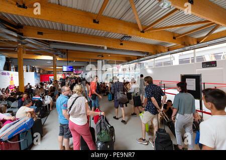 Passengers inside the Billi terminal, Bordeaux airport, Bordeaux France Europe - Stock Photo