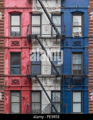 Fire escapes of a colorful building in New York City - Stock Photo
