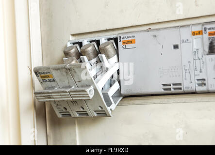Milan , Italy - June 30, 2018: Electricity main center and old electrical fuse box with porcelain fuses - Stock Photo