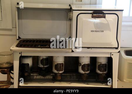 Old New Perfection kerosene stove - Stock Photo