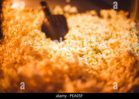 Popcorn machine made in vintage style, with sign Pop Corn on it front vintage color - Stock Photo
