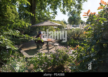 Tourists Sitting in a Cafe Regents Park London UK - Stock Photo