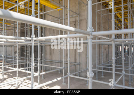 metal and wood scaffolding and supports, construction equipment - Stock Photo